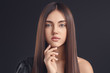 canvas print picture - Young woman with beautiful straight hair on dark background