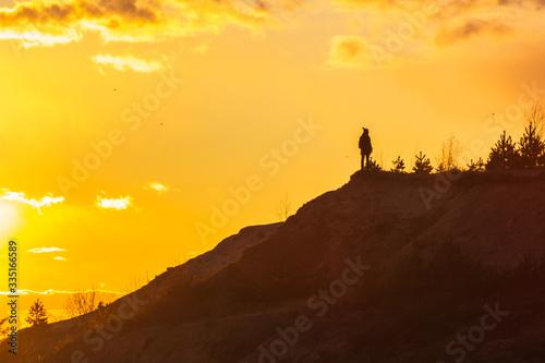 Obraz man at the top enjoying the sunset wanderlust happiness - fototapety do salonu