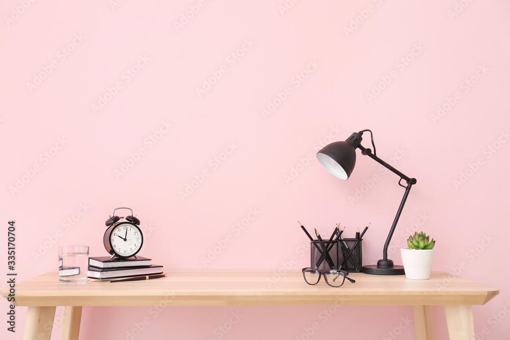 Fototapeta Modern stylish workplace near color wall