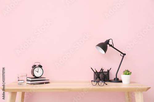 Obraz Modern stylish workplace near color wall - fototapety do salonu