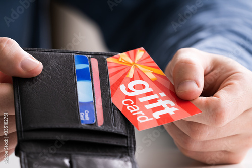 Fotomural Human Hand Removing Gift Card From Wallet