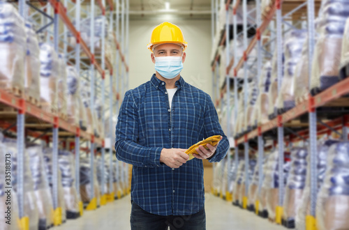 wholesale, logistic, people and export concept - male worker in safety helmet we Fototapet