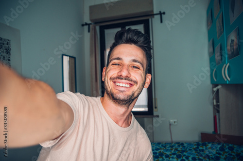Cuadros en Lienzo Handsome caucasian man taking a self portrait indoor at home