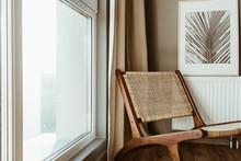 Modern Interior Design Concept. Stylish Rattan Wooden Chair, Window, Curtains. Minimal Comfortable Cozy Living Room.