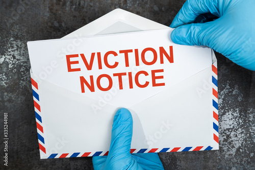 Person Holding Eviction Notice In Envelope Wallpaper Mural