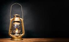 Kerosene Lamp At Night On A Wooden Table