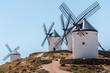 several white wooden windmills