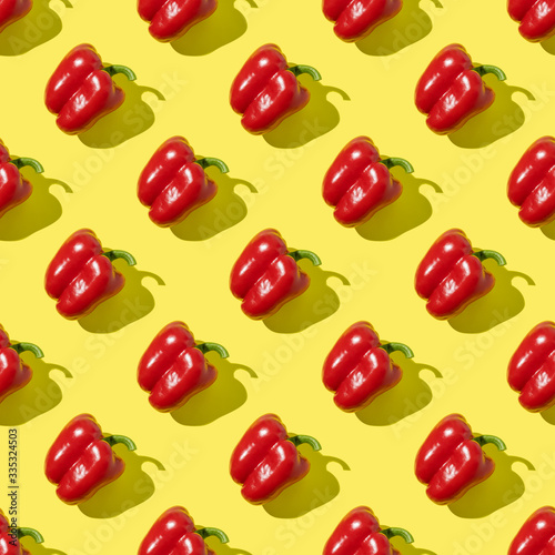 Seamless pattern of red pepper on yellow background.