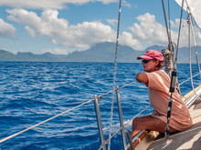 Young Woman On A Sailing Yacht...