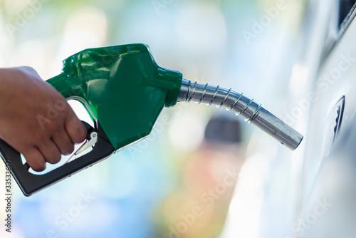 Cuadros en Lienzo Handle pumping gasoline fuel nozzle to refuel