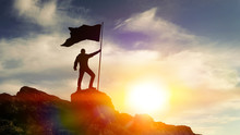 Man With Flag On Top Of The Mountain Against The Sky. Concept Business Ideas, Success And Achievement, Winner Leader.