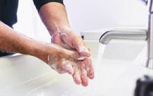 Man Washing His Hands To Preve...