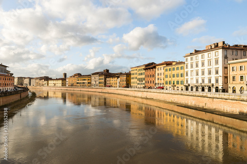 Sights of Arno River from Ponte di Mezzo Bridge in Pisa, Tuscany Region, Italy.