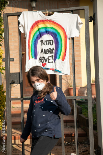 masked girl with rainbow in background everything will be fine for covid coronav Wallpaper Mural