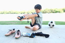 Male Child Soccer Player Dress...