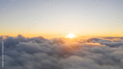 Obraz Aerial view White clouds in blue sky. View from drone. Aerial top view cloudscape. Texture of clouds. View from above. Sunrise or sunset over clouds. Panorama clouds - fototapety do salonu
