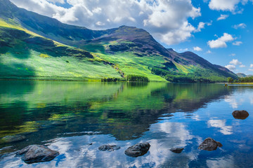 Mountains reflected on a lake at the beautiful Lake District in England