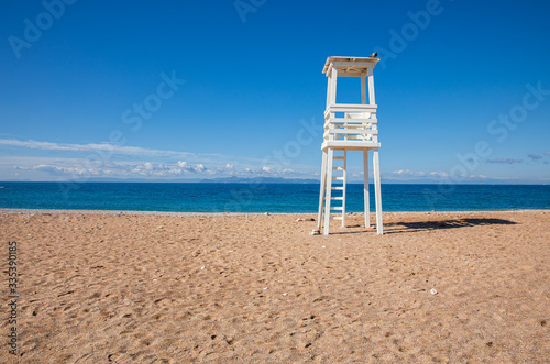 Lifeguard tower on the sandy beach of suburb in South Athens located in the Athens Riviera, Greece Wallpaper Mural