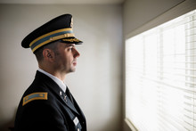 Portrait Proud Male Officer In Military Dress Uniform And Hat At Window