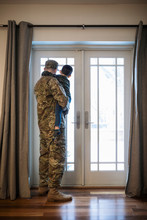 Soldier Father Holding Son At Window