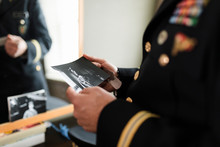 Close Up Male Military Officer Looking At Old Photograph