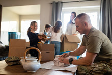 Military Family Packing Belong...
