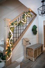 Staircase With Christmas Lights And Garland