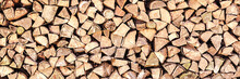 Logs Of Firewood Stacked On Co...