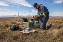 Male Wind Turbine Technician Using Drone On Sunny Wind Farm