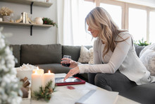 Woman Online Shopping With Cre...