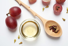 Composition With Natural Grape Seed Oil On White Background, Top View. Organic Cosmetic