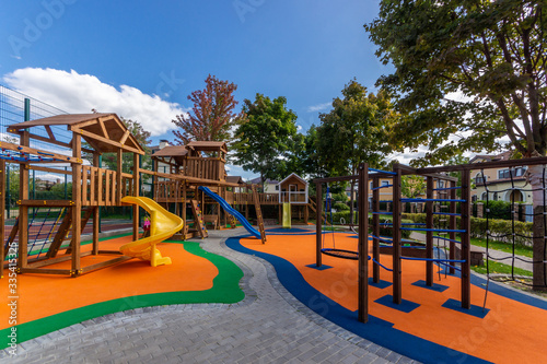Outdoor play area features toddler children's play equipment. Colorful playground