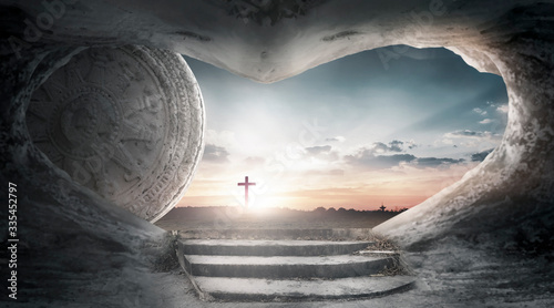 Stampa su Tela Good Friday concept: Tomb empty with cross on sunset background