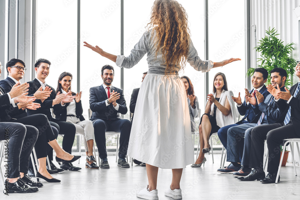 Fototapeta Businesswoman coach speaker presentation and discussing meeting strategy sharing ideas thoughts.Creative work group of casual business people clapping hands in modern office.Success concept