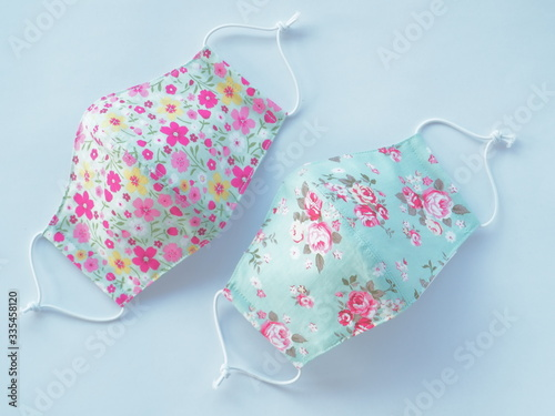 Fabric mask with sweet flower pattern. Used to prevent dust and viruses covid19 in the air