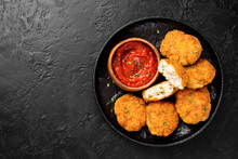 Delicious Crispy Fried Breaded Chicken Patties With Sauce On Black Background. Top View