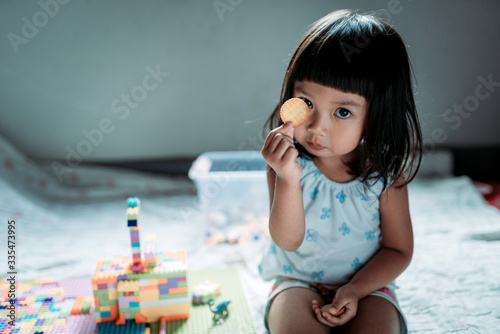 Kid enjoy eating biscuits and relax stay at home Fototapeta