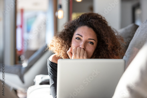 Young woman working from home for her company Wallpaper Mural