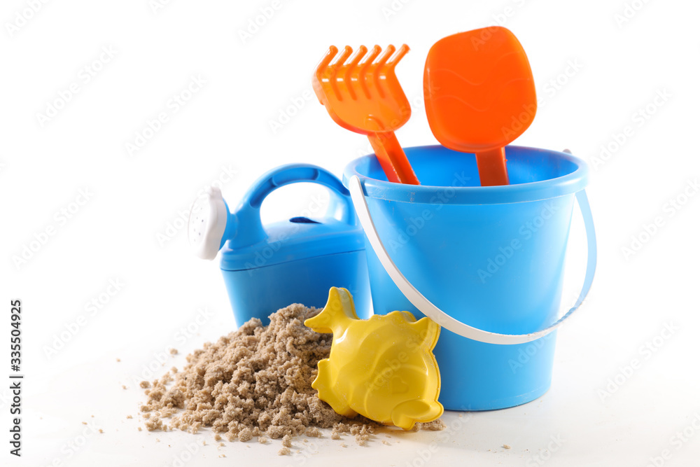 Fototapeta beach toys, sand bucket, shovel and rack isolated on white background
