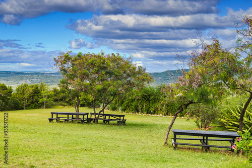 Fototapety, obrazy: A picnic area on the top of a green, tropical hillside