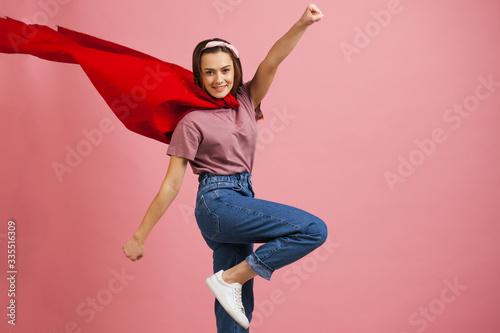 Photo Superheroine, a young female superhero in a red Cape