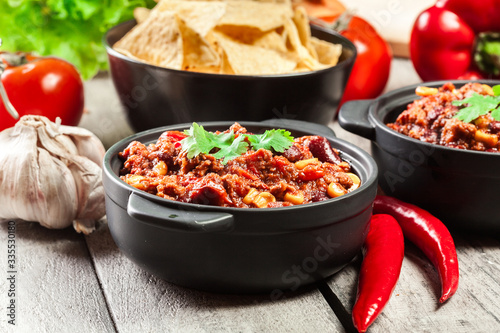 Bowls of hot chili con carne with ground beef, beans, tomatoes and corn Canvas