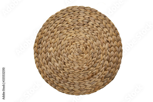 Round woven straw mat isolated against white background Canvas Print