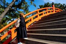 Tourist Woman Walking On The Orange Bridge