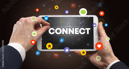 Close-up of a touchscreen with CONNECT inscription, social networking concept