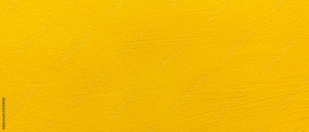 Obraz Blurred Yellow stucco wall background. Yellow painted cement wall texture. fototapeta, plakat