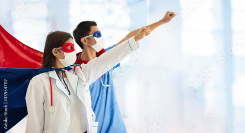 Doctor or nurse in face mask and superhero cape. - 335547117
