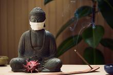 Masked Buddha Contemplates Cov...