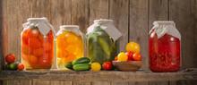 Canned Vegetables In Jars On Wooden Shelf