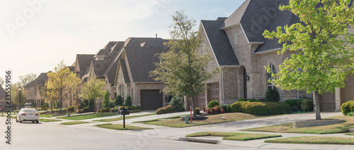 Fotografering Panoramic view upscale residential neighborhood with two story houses in suburbs